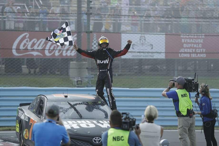 Martin Truex Jr. celebrates after winning the NASCAR Cup Series auto race, Sunday, Aug. 6, 2017, in Watkins Glen, N.Y. (AP Photo/Matt Slocum) Photo: Matt Slocum, Associated Press