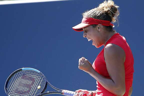 Madison Keys, of the United States, celebrates after defeating Coco Vandeweghe, of the United States, during the finals of the Bank of the West Classic tennis tournament in Stanford, Calif., Sunday, Aug. 6, 2017. (AP Photo/Tony Avelar)