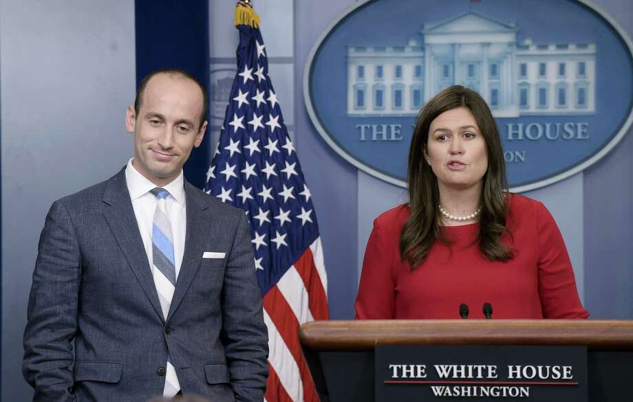 Susan Walsh / associated press White House press secretary Sarah Huckabee Sanders, right, introduces White House senior policy adviser Stephen Miller to speak during the daily briefing at the White House in Washington. / Copyright 2017 The Associated Press. All rights reserved.