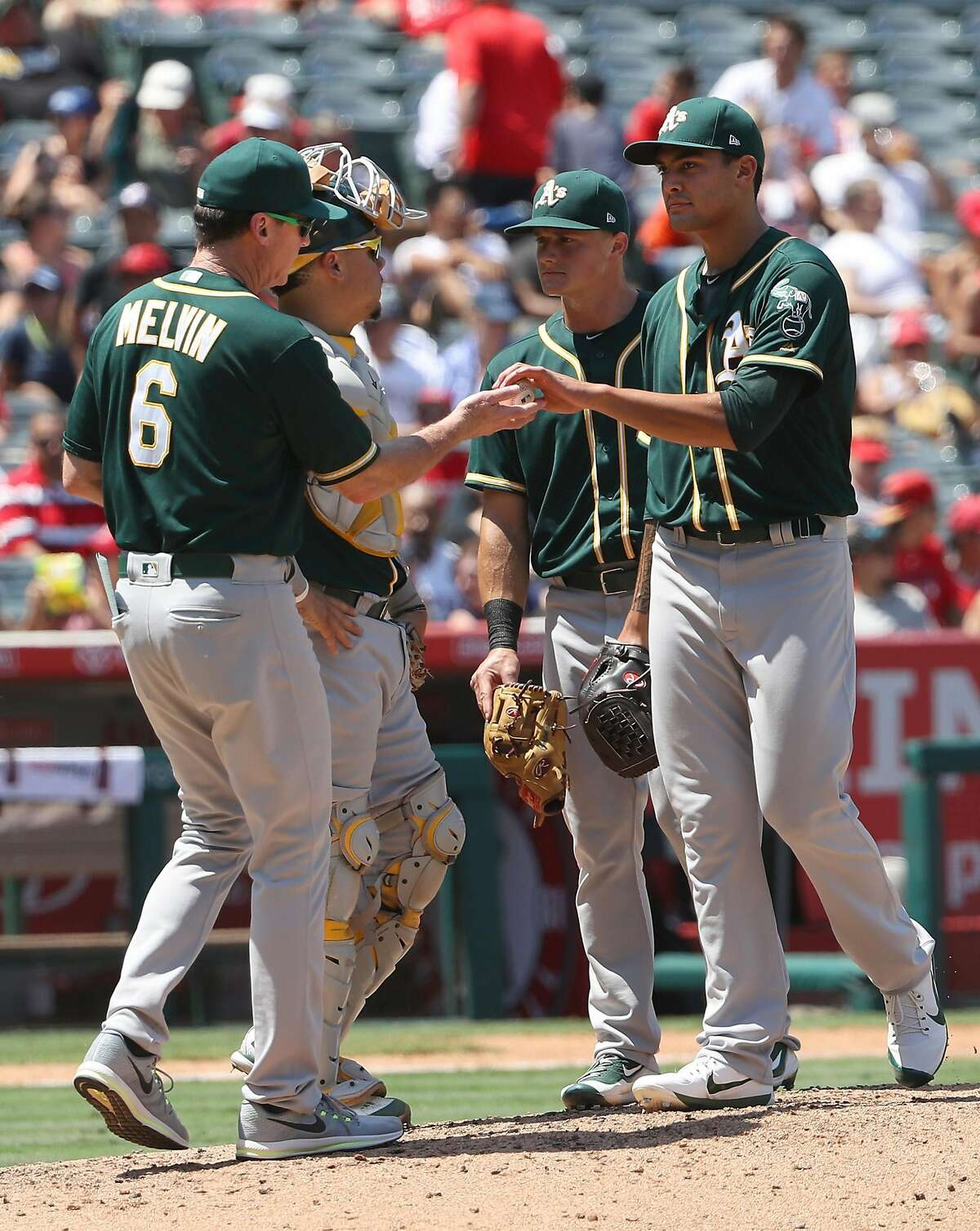 ANAHEIM, CA - AUGUST 06: Manager Bob Melvin #6 of the Oakland Athletics takes out pitcher Sean Manaea #55 of the game in the fourth inning of the MLB game against the Los Angeles Angels of Anaheim at Angel Stadium of Anaheim on August 6, 2017 in Anaheim, California. (Photo by Victor Decolongon/Getty Images)