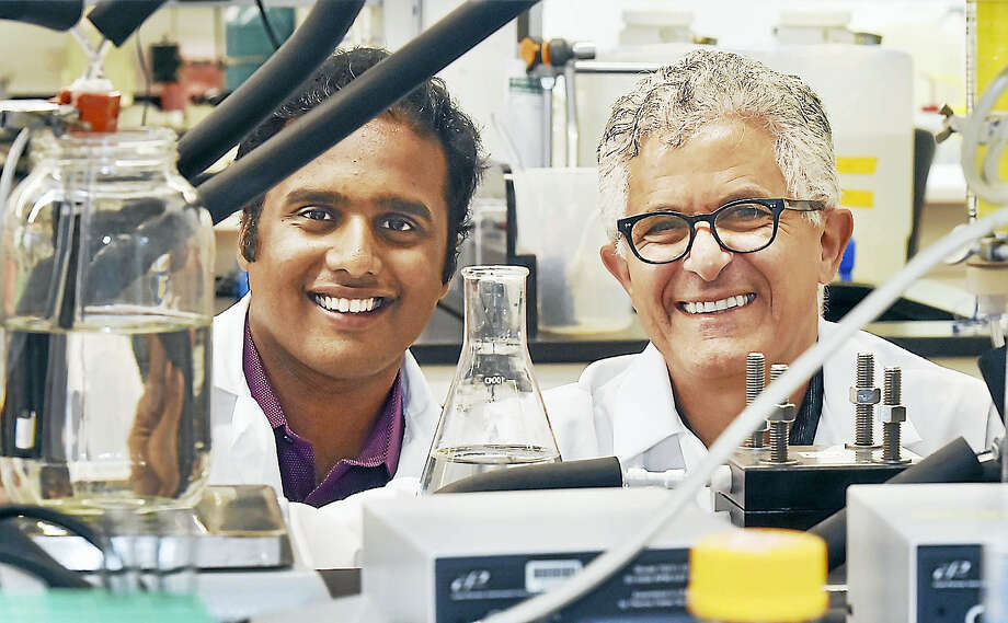 Akshay Deshmukh, a PhD candidate and Professor Menachem Elimelech, director of the chemical and environmental engineering department at Yale University are seen in the lab at 17 Hillhouse Ave. in New Haven. Photo: Catherine Avalone / Hearst Connecticut Media / Catherine Avalone | Hearst Connecticut Media
