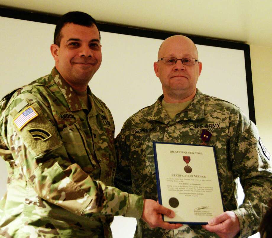 From the left, U.S. Army National Guard Soldier, Chief of Staff John Andonie presents Lt. Col Robert Giordano of Joint Force Headquarters-N.Y., a certificate of Service in Joint Force Headquarters, Latham, N.Y.,  Giordano was being recognized for all his years of service during his retirement ceremony. (U.S. Army National Guard photo by Pfc. Andrew Valenza)