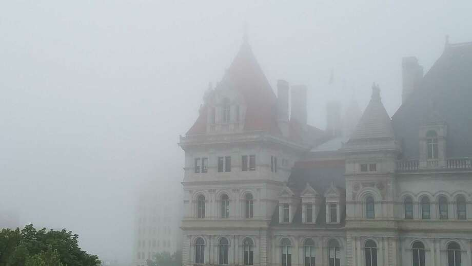 Remember that foggy morning on July 28? Eric Platt captured these images in the capital city on his way into work that day.