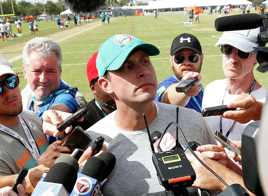Miami Dolphins head coach Adam Gase, center, talks with members of the media after an NFL football training camp, Friday, Aug. 4, 2017, at the Dolphins training facility in Davie, Fla. (AP Photo/Wilfredo Lee) ORG XMIT: FLWL115 Photo: Wilfredo Lee / Copyright 2017 The Associated Press. All rights reserved.