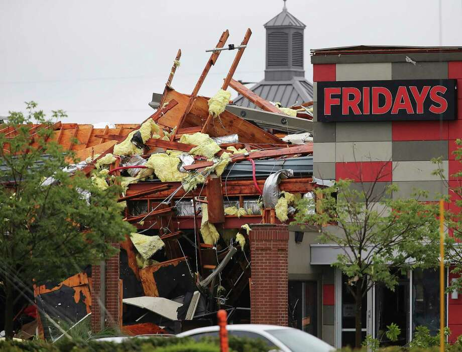 This photo shows damage to a Fridays restaurant after a storm moved through the area in Tulsa, Okla., Sunday, Aug. 6, 2017. A possible tornado struck near midtown Tulsa and causing power outages and roof damage to businesses. (Tom Gilbert/Tulsa World via AP) Photo: Tom Gilbert, MBI / TULSA WORLD