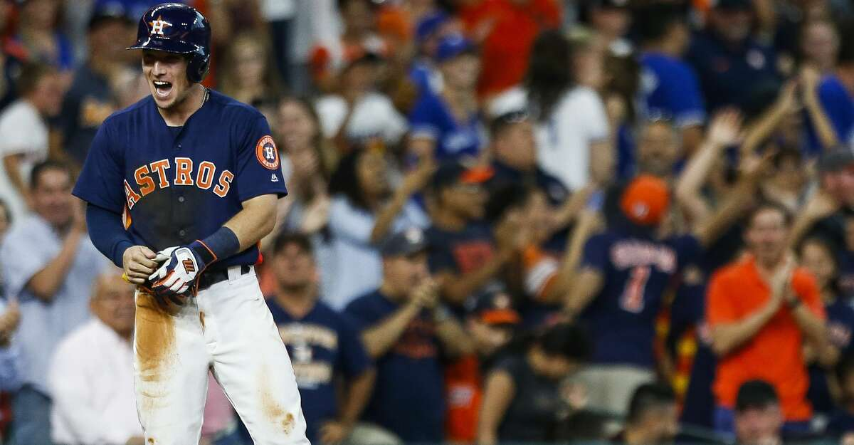 Houston Astros third baseman Alex Bregman (2) reacts after hitting a two run triple to tie the Toronto Blue Jays 6-6 during the ninth inning. The Houston Astros scored four runs in the ninth to beat the Toronto Blue Jays 7-6 Sunday, Aug. 6, 2017 in Houston. ( Michael Ciaglo / Houston Chronicle )