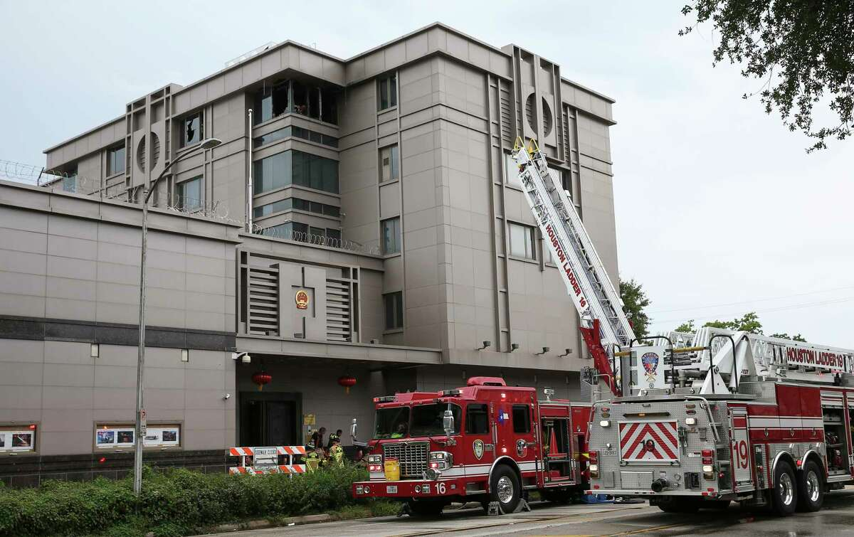 Houston Fire Department firefighters responde to a two-alarm fire at the Consulate General of the People's Republic of China on Montrose Boulevard Sunday, Aug. 6, 2017, in Houston. Dozens of fire trucks were at the scene and no one was injured.
