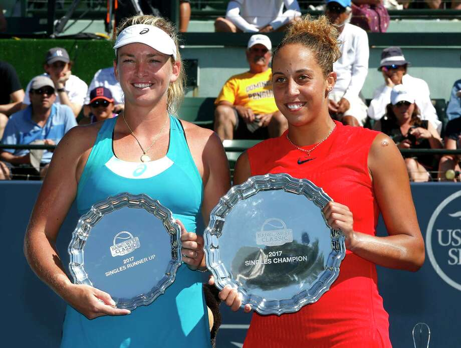 Madison Keys, right, of the United States, holds the winner's plate next to Coco Vandeweghe, left, of the United States, with the runner-up plate, after the final in the Bank of the West Classic tennis tournament in Stanford, Calif., Sunday, Aug. 6, 2017. (AP Photo/Tony Avelar) ORG XMIT: CATA118 Photo: Tony Avelar / FR155217 AP