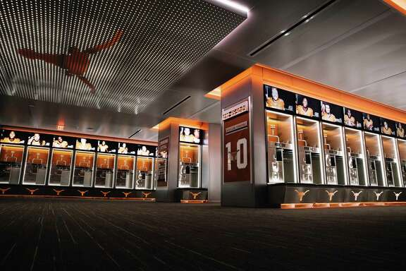 Texas' new-look locker room inside the Moncrief-Neuhas Athletic Center includes 43-inch televisions above each player's stall.