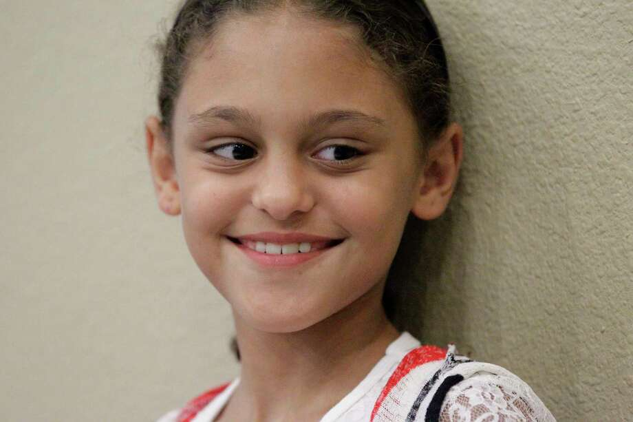 Naba'a Rabaia, 9, traveled alone from Mayathaloni, Jenin, West Bank for surgery to repair a Developmental Dysplasia of the hip.  She was photographed Sunday, Aug. 6, 2017, in Richmond. Photo: Steve Gonzales, Houston Chronicle / © 2017 Houston Chronicle