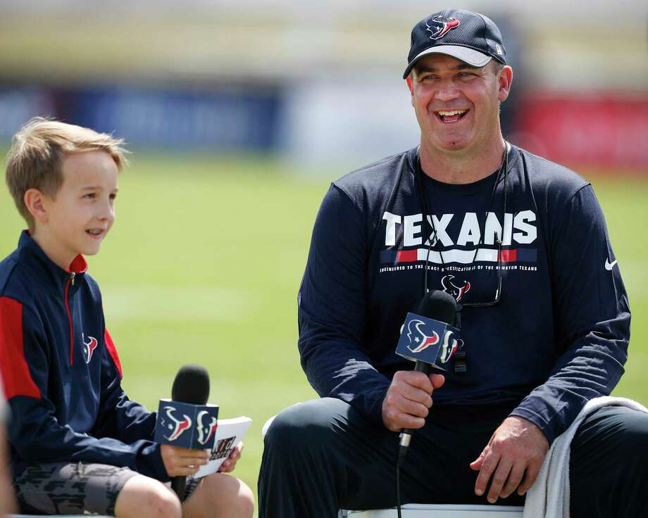 "Texans ""kid reporter"" Luke Vandermeer catches coach Bill O'Brien at ease during a training camp get-together last week. Photo: Brett Coomer, Staff / © 2017 Houston Chronicle}"