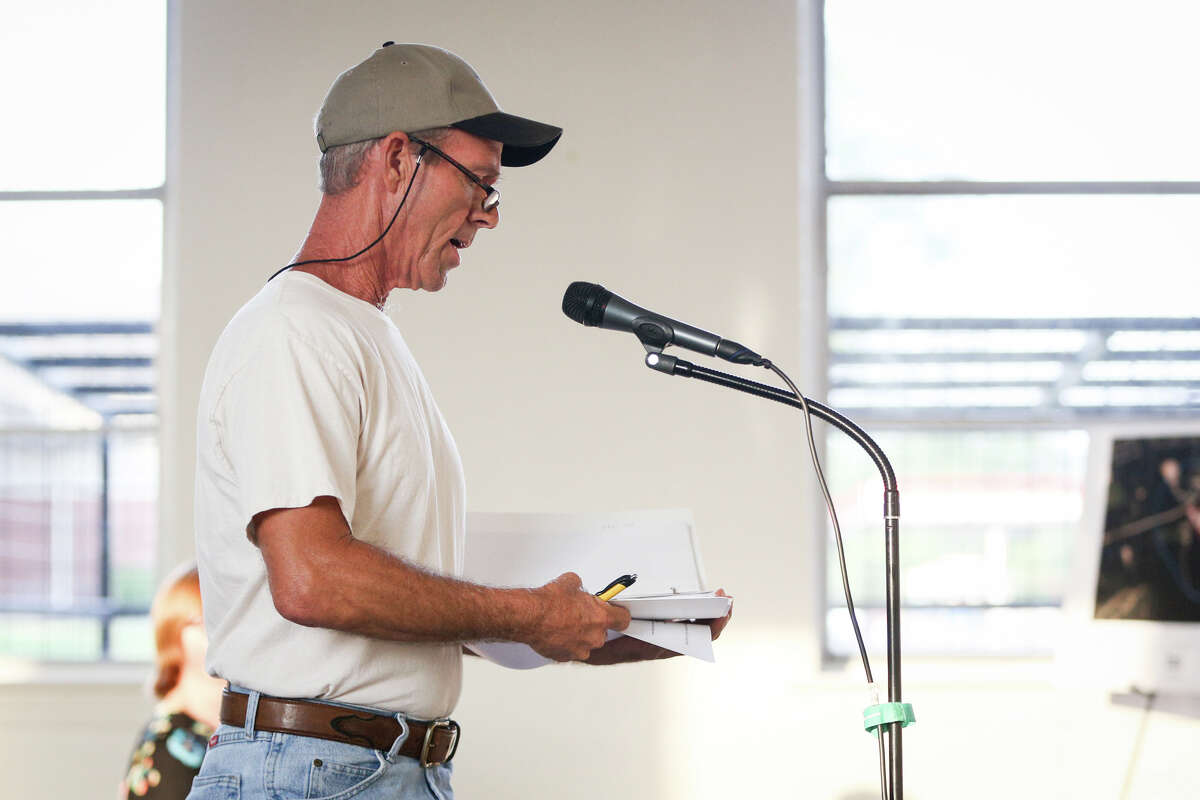 James Elam, who's home is adjacent to K&K Construction's facility, speaks during the Texas Commission on Environmental Quality's meeting on Tuesday, Aug. 1, 2017, at the Willis Community Center.