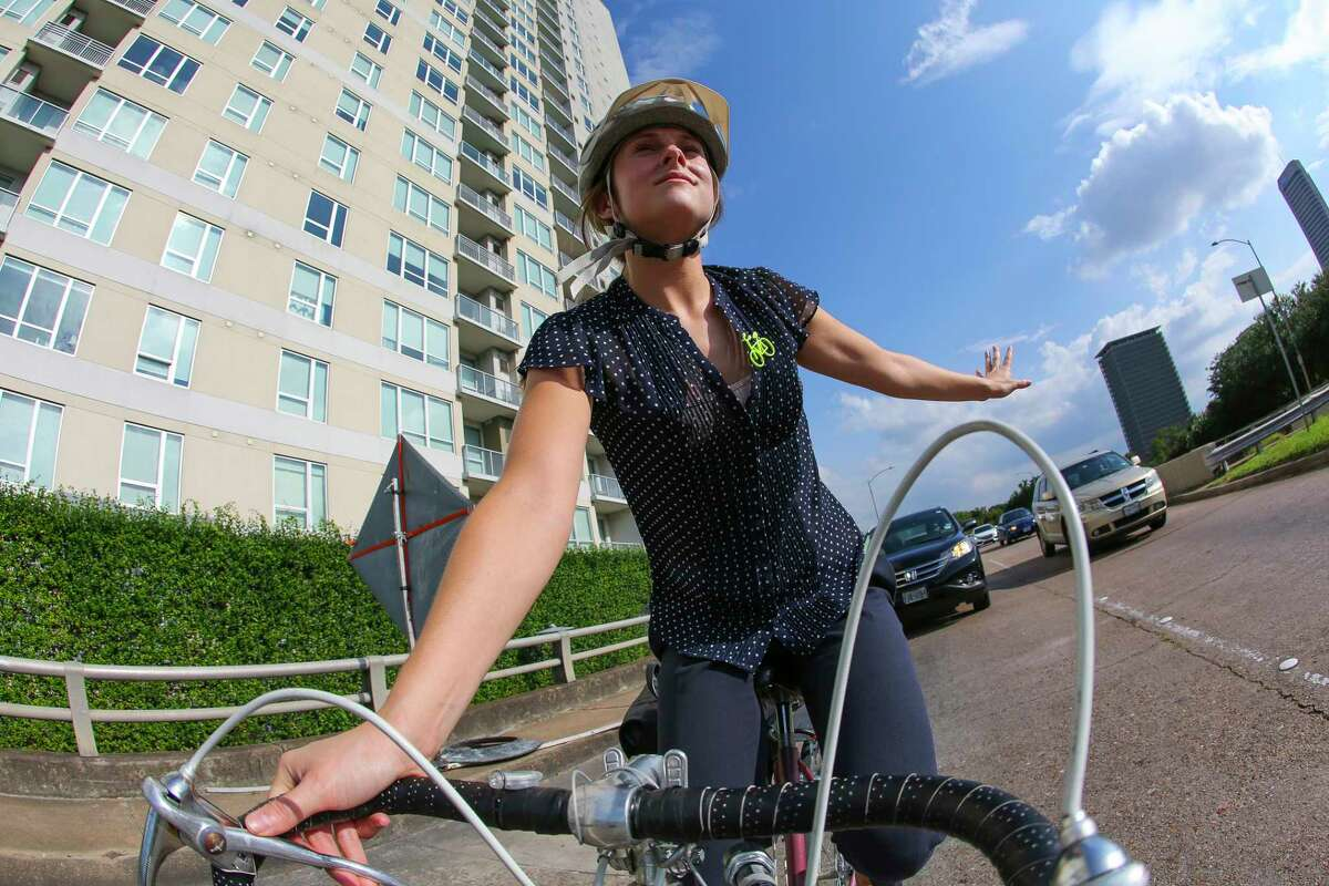 Jessica Wiggins navigates road construction along Montrose while commuting to the Heights last week.