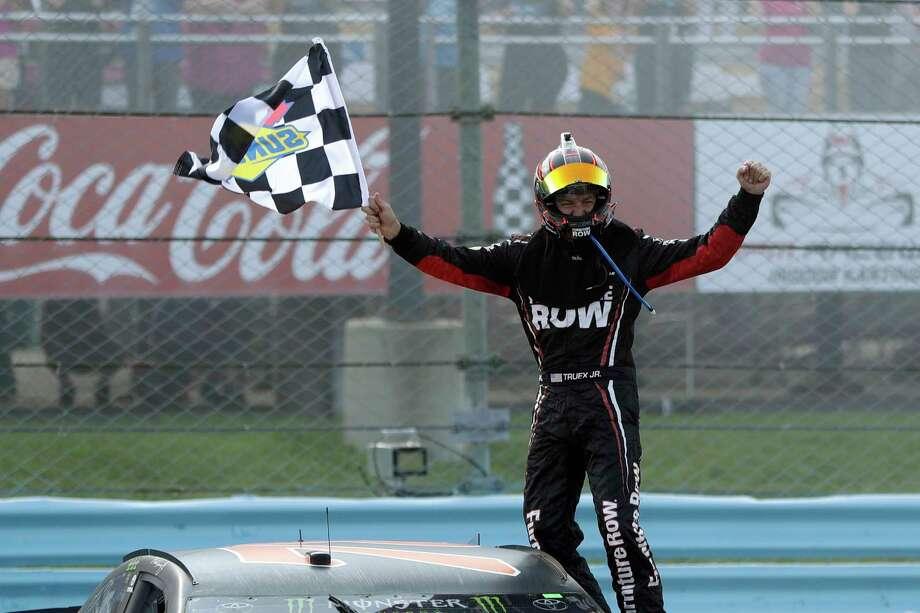 Martin Truex Jr. celebrates after winning the NASCAR Cup Series auto race, Sunday, Aug. 6, 2017, in Watkins Glen, N.Y. (AP Photo/Matt Slocum) ORG XMIT: NYMS111 Photo: Matt Slocum / Copyright 2017 The Associated Press. All rights reserved.