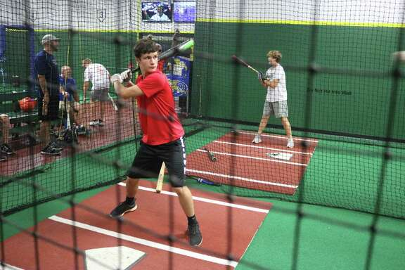 Cole Bratten works on his hitting at Pasadena's 3K batting cages  two days before the team left for Louisiana and the South Zone Tournament.