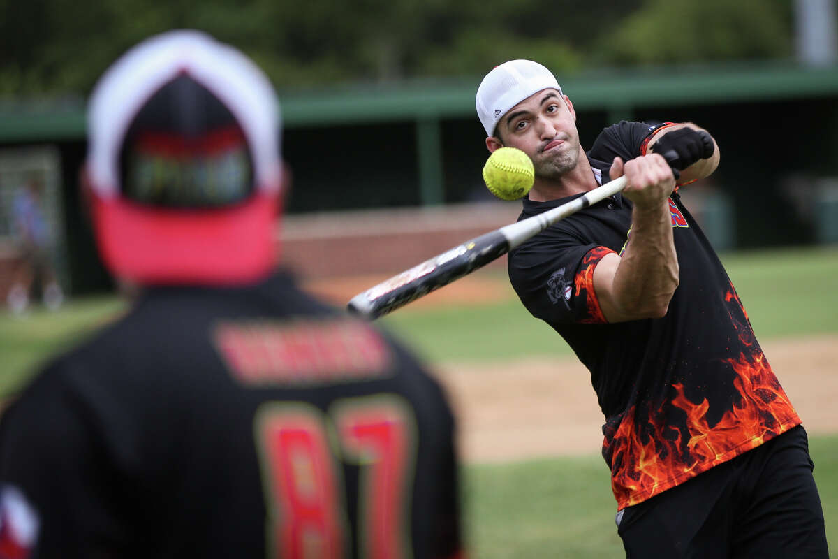 Christian Parsons (203), of The Woodlands Fire Department, bats during warmups before the Boots vs Badges softball game on Sunday, Aug. 6, 2017, at McCullough Junior High School.