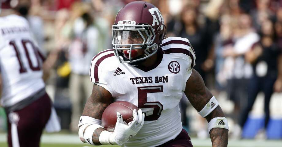 Last season Trayveon Williams, a C.E. King graduate, became the first true freshman in A&M history to rush for more than 1,000 yards (1,057 on 156 carries). Photo: Rogelio V. Solis/Associated Press
