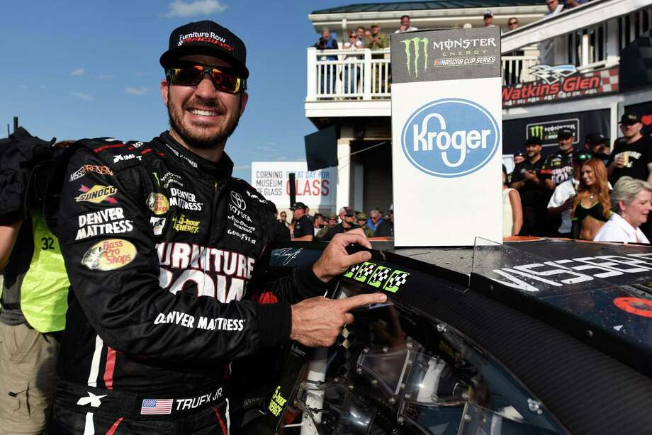 WATKINS GLEN, NY - AUGUST 06:  Martin Truex Jr., driver of the #78 Furniture Row/Denver Mattress Toyota, celebrates his fourth win by adding the winner's sticker to his car in Victory Lane after winning the Monster Energy NASCAR Cup Series I Love NY 355 at The Glen at Watkins Glen International on August 6, 2017 in Watkins Glen, New York.  (Photo by Jared C. Tilton/Getty Images) Photo: Jared C. Tilton, Stringer / 2017 Getty Images