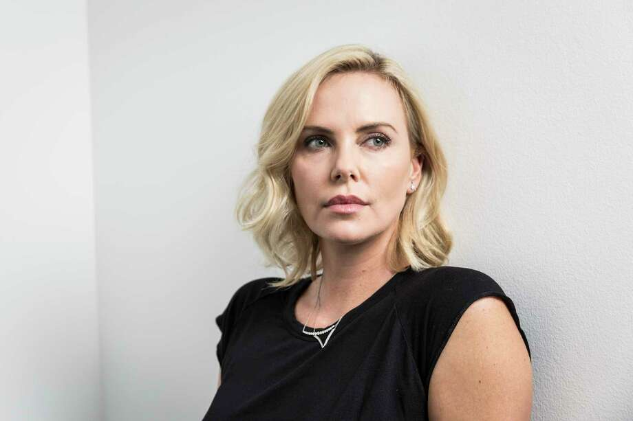 """Charlize Theron, star of the new movie """"Atomic Blonde,"""" in Los Angeles, June 22, 2017. The Oscar winner has a mile-wide range but has recently played a series of lethal ladies: convicted murderer Aileen Wuornos from OMonster,O Imperator Furiosa in OMad Max: Fury Road,O Ravenna in OSnow White and the HuntsmanO and now a merciless hand-to-hand combatant in the new OAtomic Blonde.O (Emily Berl/The New York Times) ORG XMIT: XNYT103 Photo: EMILY BERL / NYTNS"""