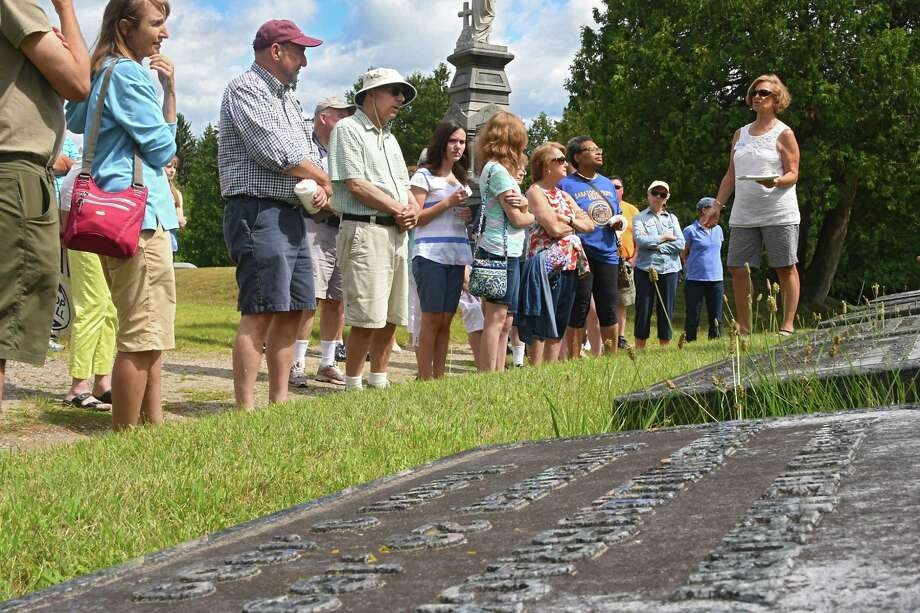 Jan Klassovity, right, talks about the Charles Brackett and family gravesite as she leads a tour and talks about the unusual crypts and history of some of SaratogaOs prominent citizens at Greenridge Cemetery on Sunday, Aug. 6, 2017 in Saratoga Springs, N.Y. (Lori Van Buren / Times Union) Photo: Lori Van Buren / 20041216A