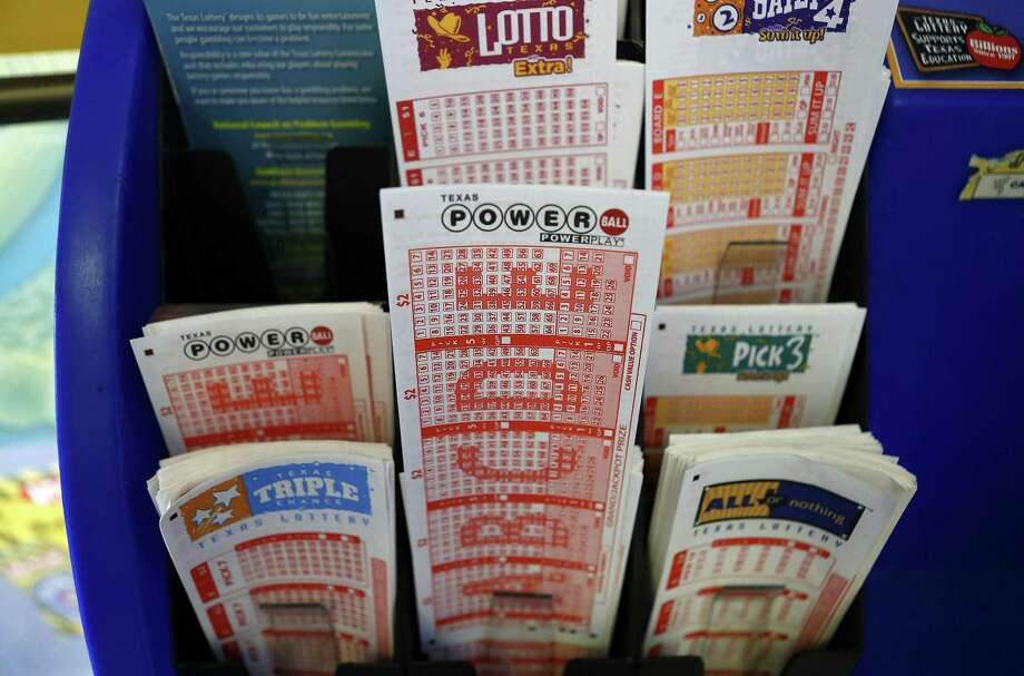 With no winning grand prize ticket, the pot for the multistate lottery is now at $750 million. Photo: Mark Mulligan, Staff / Houston Chronicle / © 2016 Houston Chronicle
