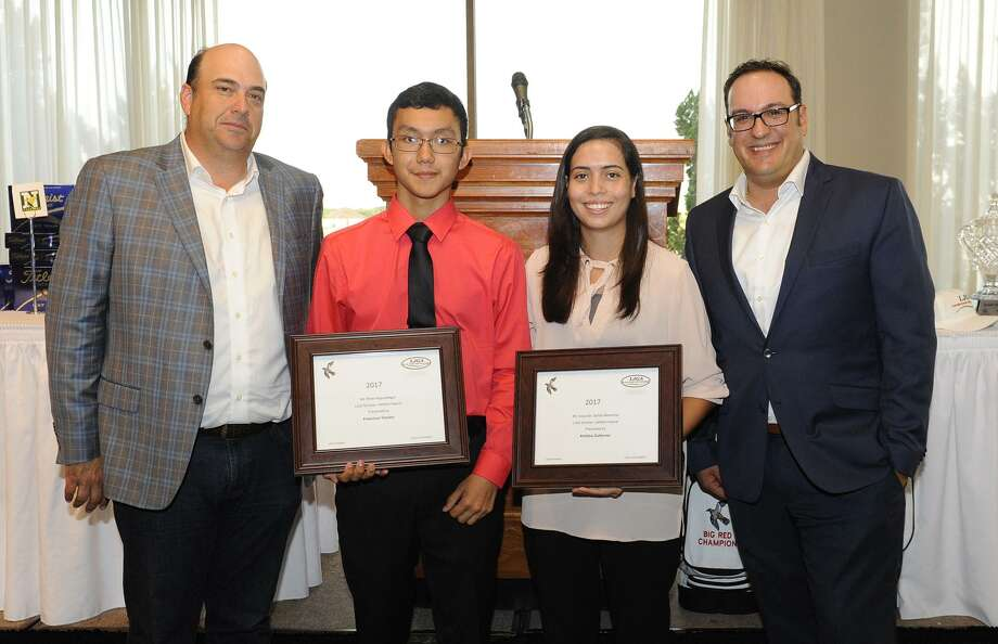 Laredo Country Club's General Manager Jeremiah Cabrera, left, and head golf professional Mike Mainhart, right, awarded Francisco Trevino and Kristina Gutierrez scholarships during a Laredo Junior Golf Association banquet on Sunday evening. Photo: Danny Zaragoza /Laredo Morning Times / Laredo Morning Times