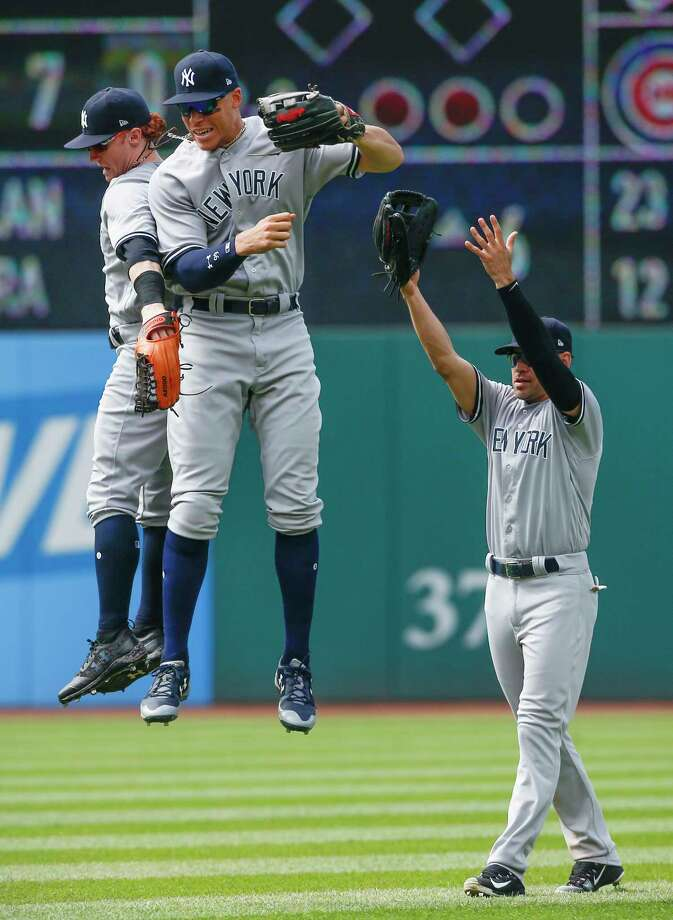New York Yankees' Clint Frazier, left, Aaron Judge, center, and Jacoby Ellsbury celebrate an 8-1 victory over the Cleveland Indians in a baseball game, Sunday, Aug. 6, 2017, in Cleveland. (AP Photo/Ron Schwane) ORG XMIT: OHRS116 Photo: Ron Schwane / AP 2017