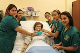 : Laredo Community College Nursing Assistant students run through various scenarios on one of the program's manikins. The Nursing Assistant certificate program is one of several nursing programs available at LCC.