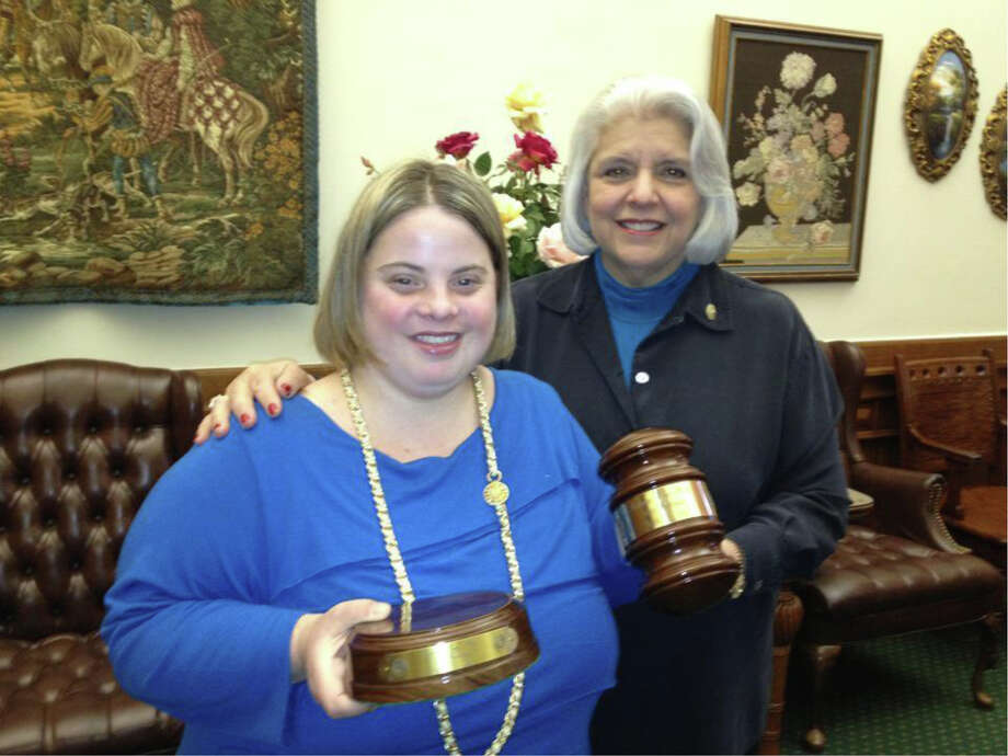 Senator Judith Zaffirini presents a gavel and sound block to Katy Hull, a self-advocate for persons with disabilities. A member of the Senate Health and Human Services Committee since 1987, the senator champions critical health care services, especially for the very young, the very old, veterans, and persons with disabilities. Photo: Courtesy