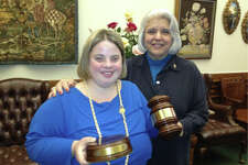 Senator Judith Zaffirini presents a gavel and sound block to Katy Hull, a self-advocate for persons with disabilities. A member of the Senate Health and Human Services Committee since 1987, the senator champions critical health care services, especially for the very young, the very old, veterans, and persons with disabilities.