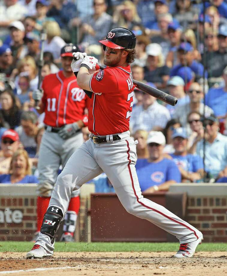 CHICAGO, IL - AUGUST 06:  Bryce Harper #34 of the Washington Nationals hits a single in the 8th inning against the Chicago Cubs at Wrigley Field on August 6, 2017 in Chicago, Illinois. (Photo by Jonathan Daniel/Getty Images) ORG XMIT: 700011926 Photo: Jonathan Daniel / 2017 Getty Images