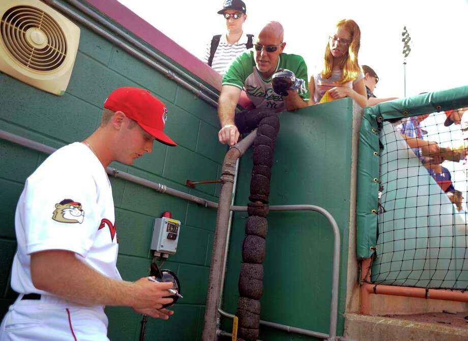 Tri-City ValleyCats' J.B. Bukauskas signs autographs for fans before a minor league baseball game against the Aberdeen Ironbirds on Sunday, Aug. 6, 2017, in Troy, N.Y. (Hans Pennink / Special to the Times Union)  ORG XMIT: HP101 Photo: Hans Pennink / Hans Pennink