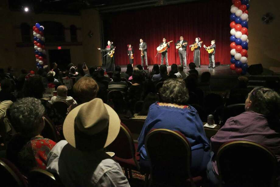 Mariachis serenade the crowd as the Guadalupe Theater celebrates its 75th anniversary on July 7. Photo: Tom Reel /San Antonio Express-News / 2017 SAN ANTONIO EXPRESS-NEWS