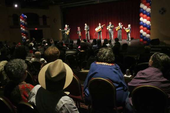 Mariachis serenade the crowd as the Guadalupe Theater celebrates its 75th anniversary on July 7.