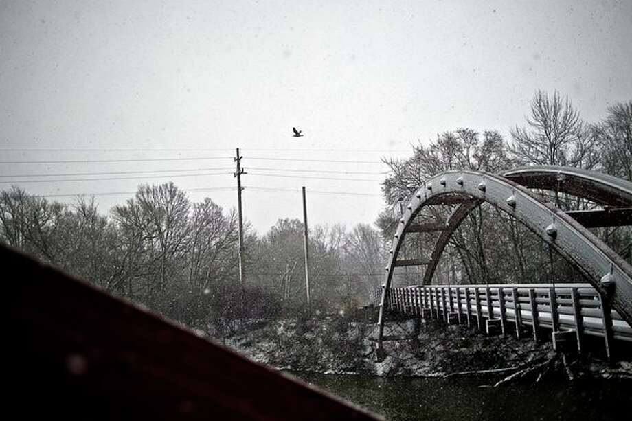ERIN KIRKLAND | ekirkland@mdn.net 				Snow accumulates on the Tridge on Wednesday afternoon.