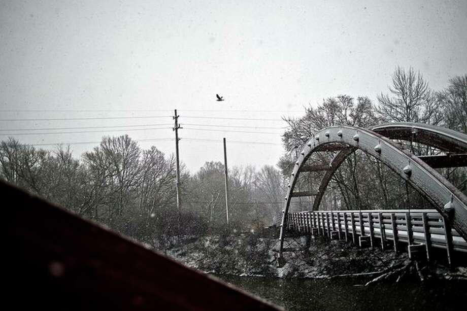 ERIN KIRKLAND | ekirkland@mdn.net Snow accumulates on the Tridge on Wednesday afternoon.