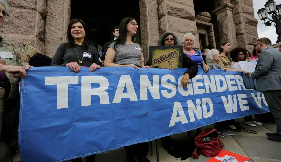 """Members of the transgender community take part in a rally on the steps of the Texas Capitol, Monday, March 6, 2017, in Austin, Texas. The group is opposing a """"bathroom bill"""" that would require people to use public bathrooms and restrooms that correspond with the sex on their birth certificate. (AP Photo/Eric Gay) Photo: Eric Gay, STF / Copyright 2017 The Associated Press. All rights reserved."""