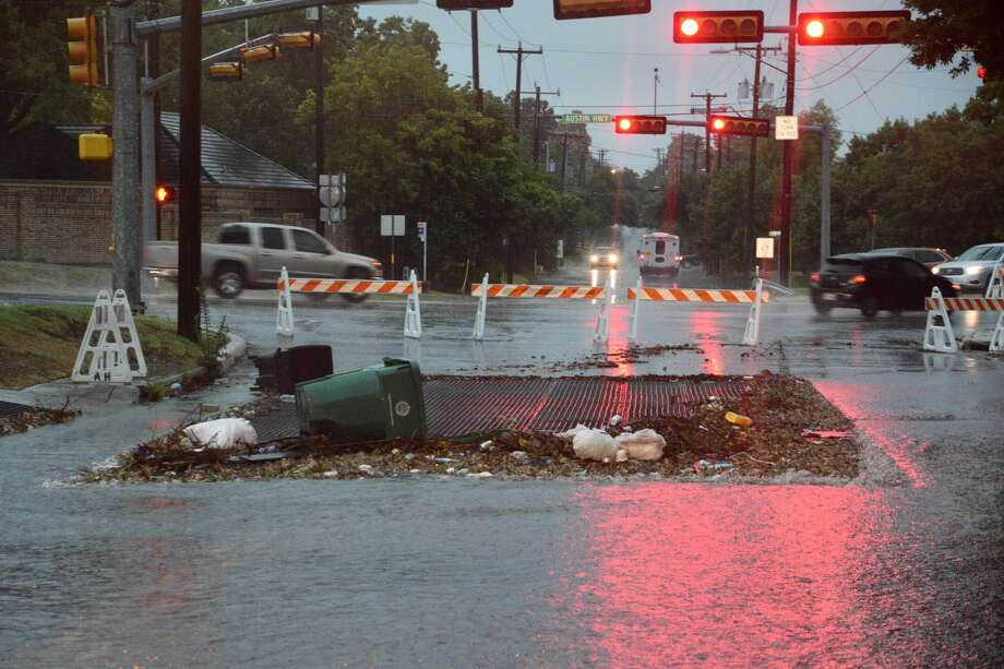Trash and debris pile on a flood grate on Monday, Aug. 7, 2017 after storms rushed through San Antonio, causing flooding in the area. Photo: Cory Heikkila / San Antonio Express-News
