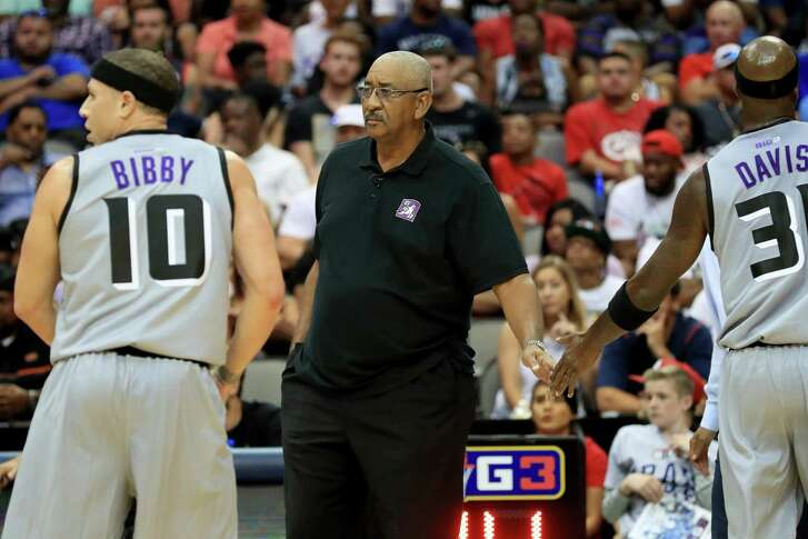 Coach George Gervin of the Ghost Ballers meets with his team during a timeout against the Trilogy during week six of the Big3 League at American Airlines Center on July 30, 2017 in Dallas.