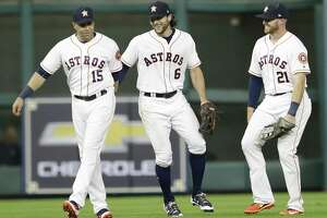 Astros players Carlos Beltran (from left) Jake Marisnick and Derek Fisher, right, celebrate win over the Tampa Bay Rays at Minute Maid Park on July 31, 2017, in Houston.