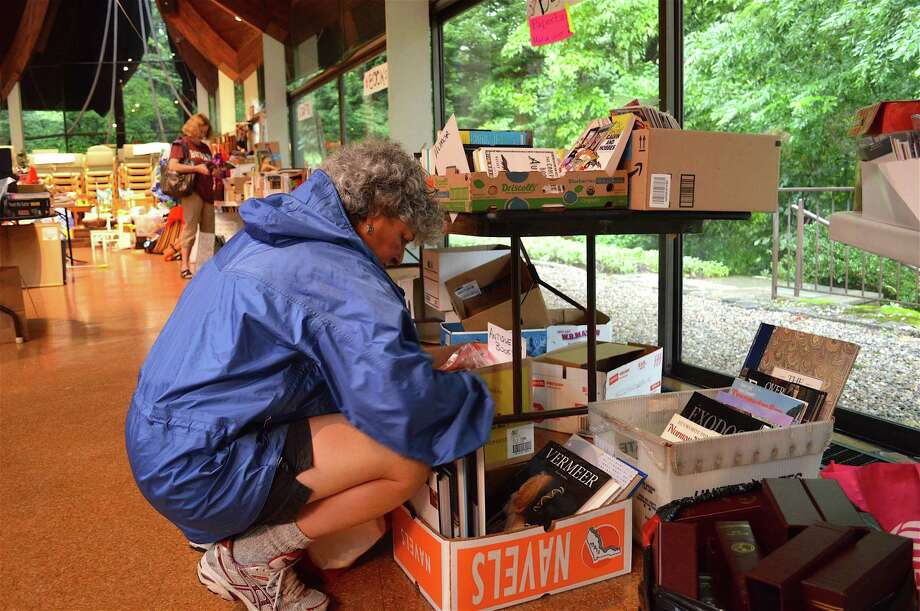 Beth Lieberman of Stamford looks through books at the Unitarian Church of Westport's 7th annual Indoor Tag Sale, Saturday, Aug. 5, 2017, in Westport, Conn. Photo: Jarret Liotta / For Hearst Connecticut Media / Westport News Freelance