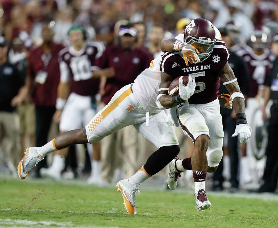 Running back Trayveon Williams (5) and the Texas A&M Aggies are not ranked in the Associated Press' preseason top 25 for the third consecutive year. Photo: Karen Warren, Staff Photographer / 2016 Houston Chronicle