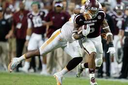 Texas A&M Aggies running back Trayveon Williams (5) runs the ball as Tennessee Volunteers linebacker Elliott Berry (41) tries to stop him during the fourth quarter of a college football game at Kyle Field, Saturday, Oct. 8, 2016 in College Station.  ( Karen Warren / Houston Chronicle )