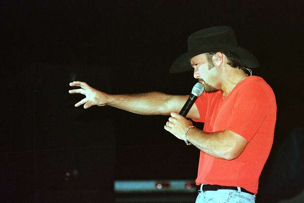 Tim McGraw reaches toward the audience during his concert at the Midland County Fair. 1997