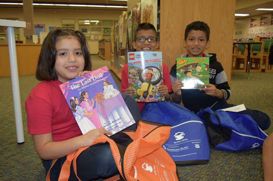 Students at Treasure Forest Elementary School proudly display their new books they received from the foundations My Home Library program. Photo: Barbara Bush Literacy Foundation