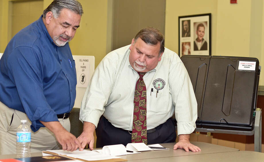 Armando X. Lopez and County Elections Coordinaor, Oscar Villareal, go over the results of the voting equipment tests, before preparing to mail them out, Tuesday afternoon at the Bill Hall Webb County Administration Building. Photo: Laredo Morning Times