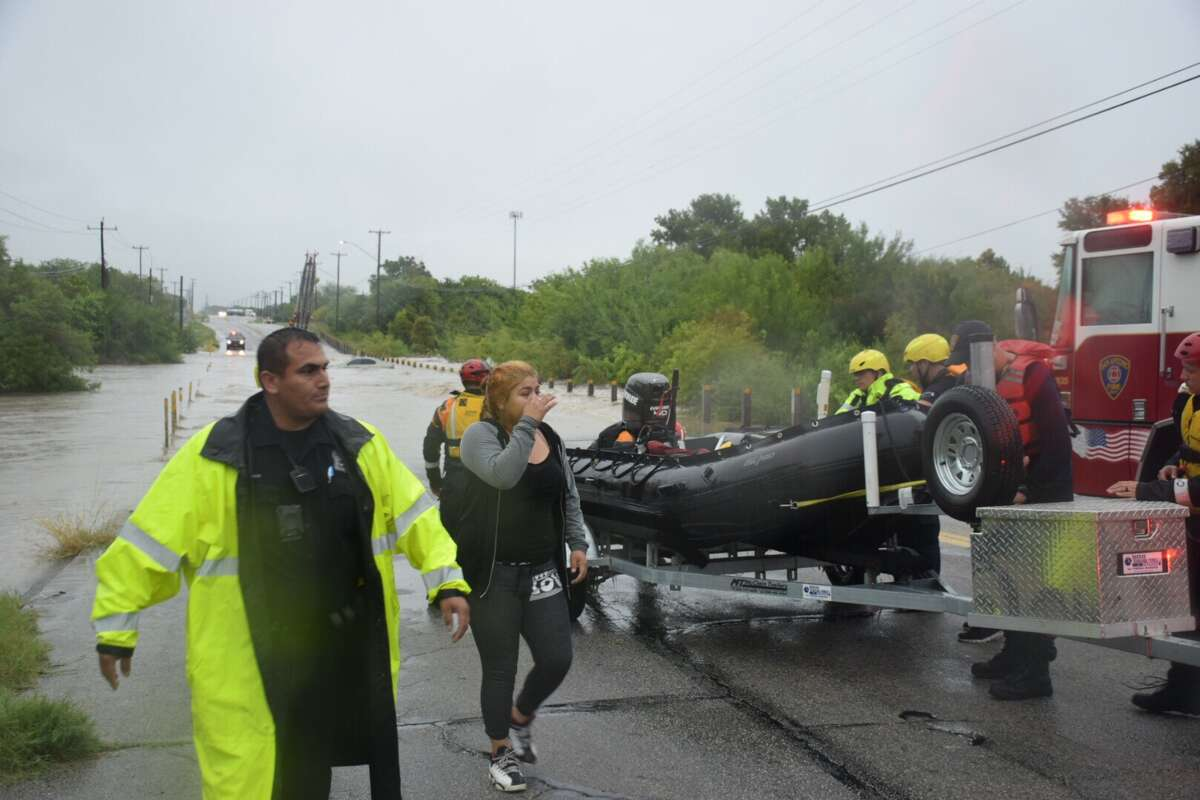 Authorities on Monday rescued two divers whose cars became submerged less than a mile apart from each other.