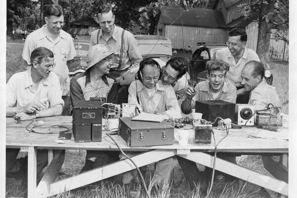 Amateur radio enthusiasts made about 100 contacts when they participated in the national contest The hams contacted other operators in 25 states and used the 80, 40, 20, 10 and six bands, which are the amateur bands generally used. From left, seated, C.E. Bud Price, W.M. Murch, Jack Keaner, K.C. McQuiston and Ray E. Lane; standing, Aaron Boroks, W.A. Stelzer, A.S. Townsend and paul Sheffield. June 1959