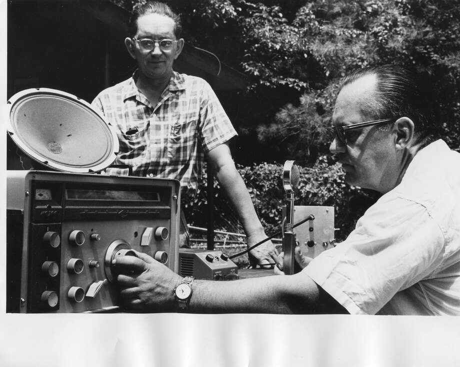 Clair Parker, president of the Midland Amateur Radio Club, observes Dr. Lynn Hooker as he makes a radio contact in the field day at Barstow Woods. June 1962  Photo: Daily News File Photo