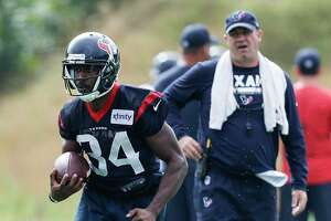Houston Texans running back Tyler Ervin (34) runs with the football as head coach Bill O'Brien looks on during training camp at the Greenbrier on Monday, Aug. 7, 2017, in White Sulphur Springs, W.Va.